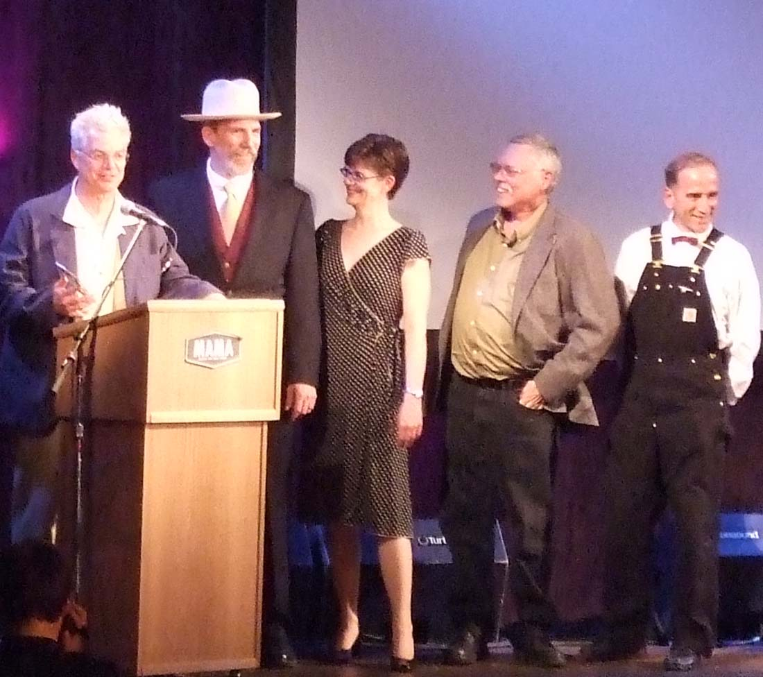 Sparetime accepting the MAMA (Madison Area Music Award)